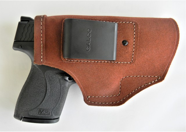 S&W pistol in leather holster