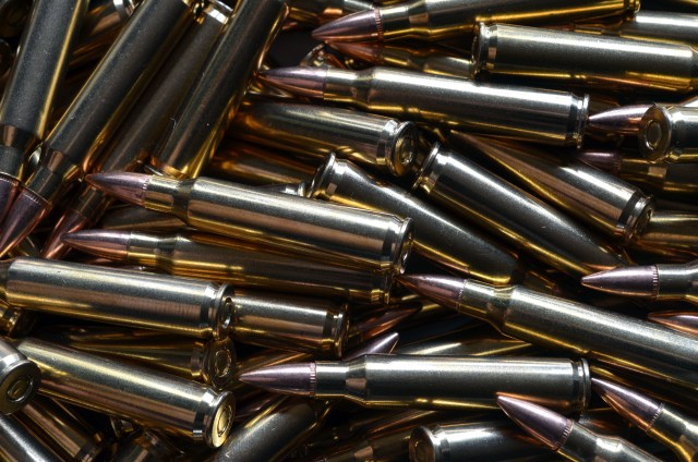 pile of .223 remington ammo varmint cartridges