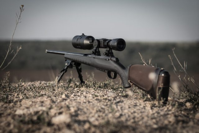 bolt action rifle with night vision optics, thermal imager, ballistic calculator, soft focus, backlight, entourage.