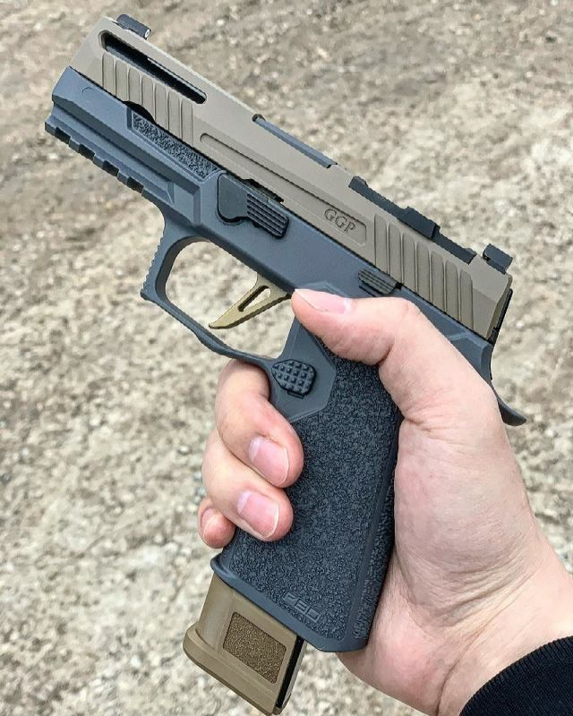 upgraded SIG P320 Pistol in hand