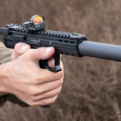 Man shooting kel-tec CP33 pistol with red dot