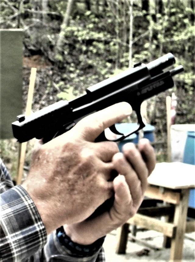man reloading pistol