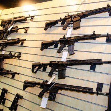 AR-15 rifles on wall rack