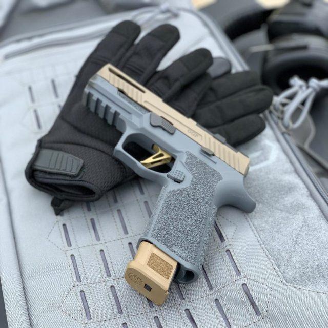 Custom SIG p320 pistol on shooting gloves