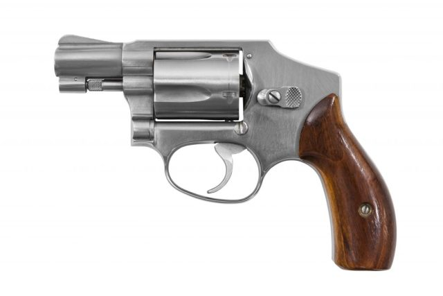 Five shot 38 caliber single action revolver handgun isolated with clipping path.
