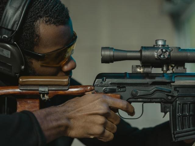 man shooting AK-47 trigger actions