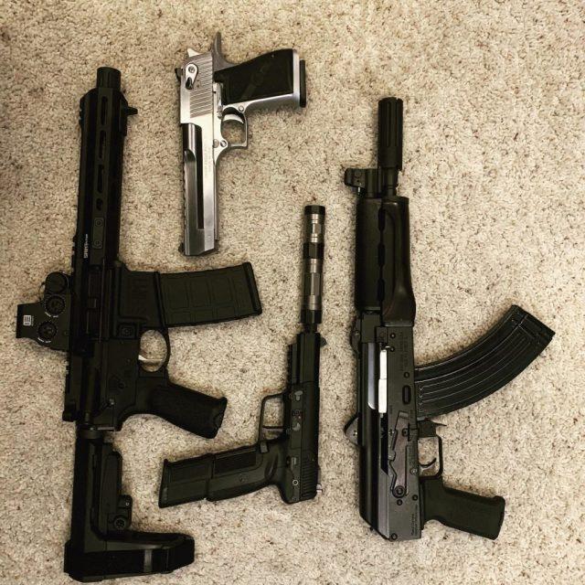 AR pistol, AK pistol, Desert Eagle and FN 5.7 pistol on carpet