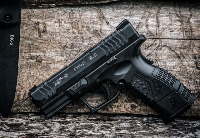 Springfield pistol leaning on wall