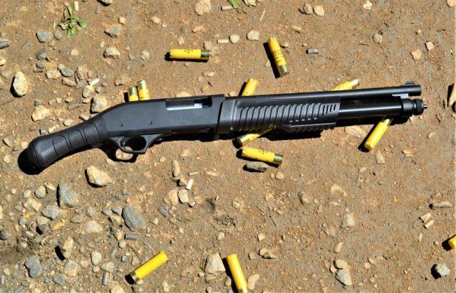 Birdshead grip pump-action shotgun
