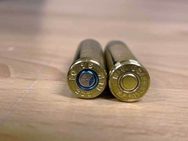 .223 Remington cartridge next to 5.56 NATO cartridge