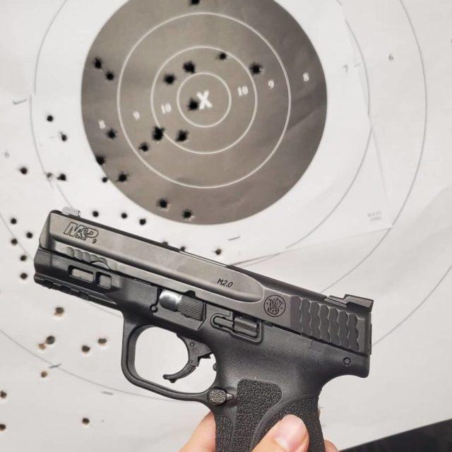 S&W M&P pistol in front of target