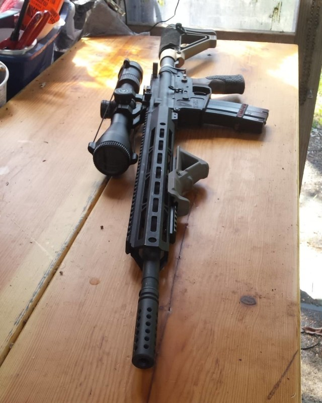 AR-15 with scope on table
