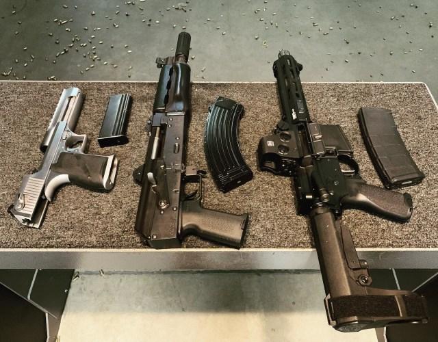 Desert Eagle, AK and AR pistols on range bench