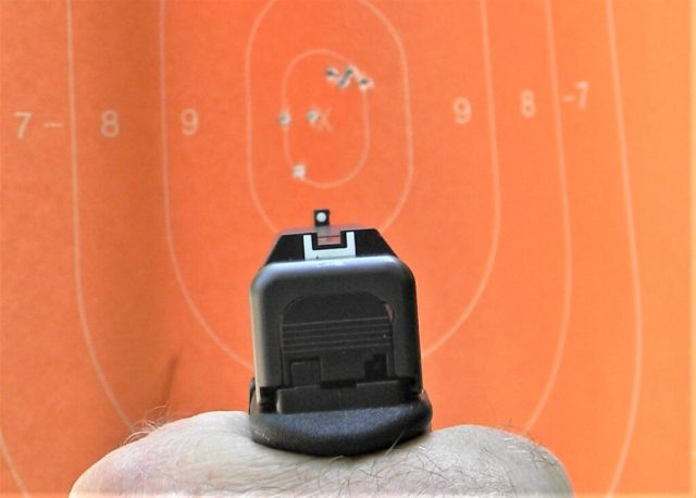 pistol pointed at target to aim faster