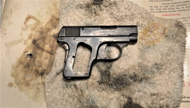 small pistol that has been re-blued for firearm restoration