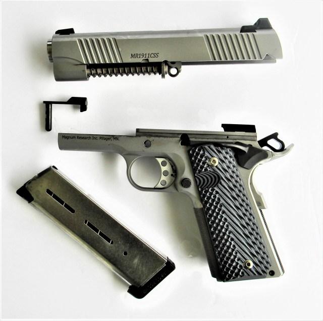 Field stripped magnum research 1911 Commander pistol w magazine