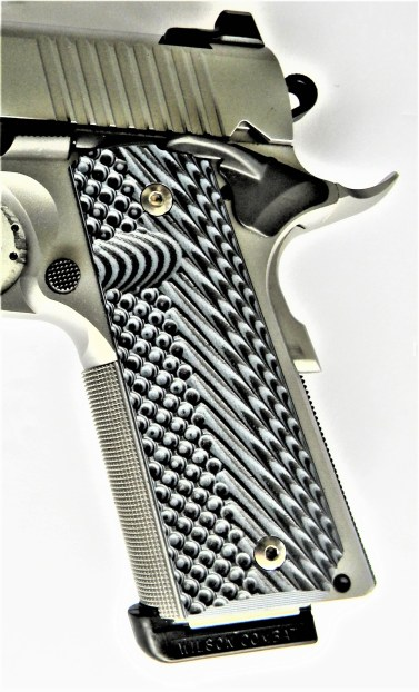 G10 grips on affixed to a 1911 pistol frame