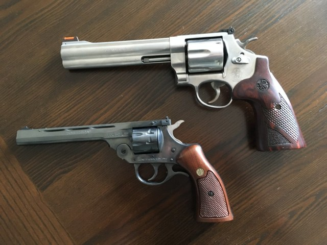 Two S&W revolvers on wood table