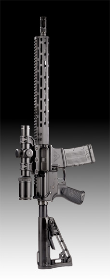 Wilson Combat Protector AR-15 shown vertically with the muzzle brake pointing up