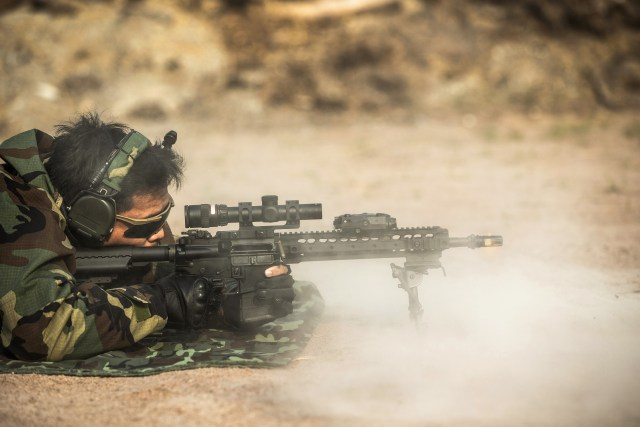 Man firing AR-15 rifle while prone