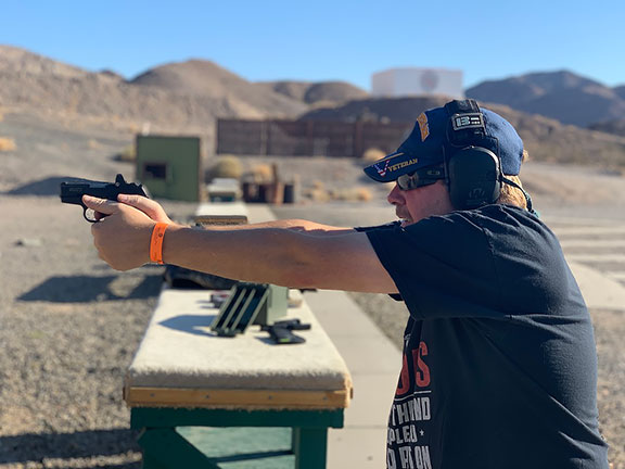 Dave Dolbee shooting the SCCY CPX-2RD handgun at an outdoor shooting range
