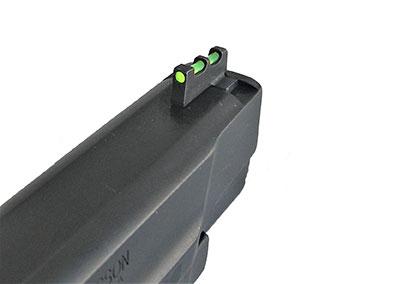 green fiber optic front sight on a pistol
