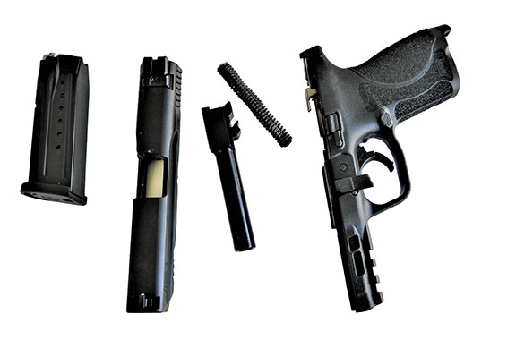 field stripped Smith & Wesson Military & Police 2.0 handgun