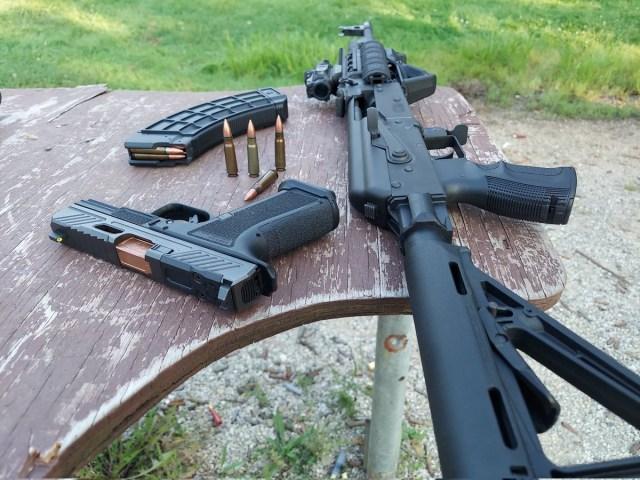 AK Rifle and Handgun on Range Table