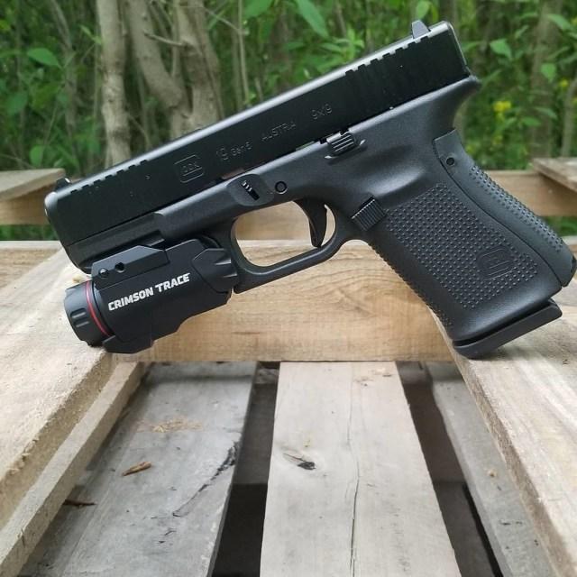 Glock 19 Gen 5 pistol wit flashlight