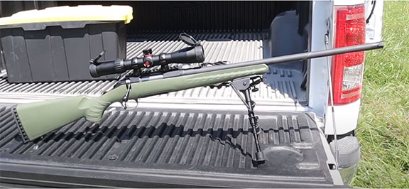 Ruger American rifle with bipod and scope on the tailgate of a truck