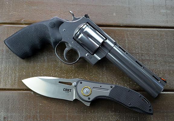 CRKT XOC knife designed by Flavio Ikoma with a black revolver
