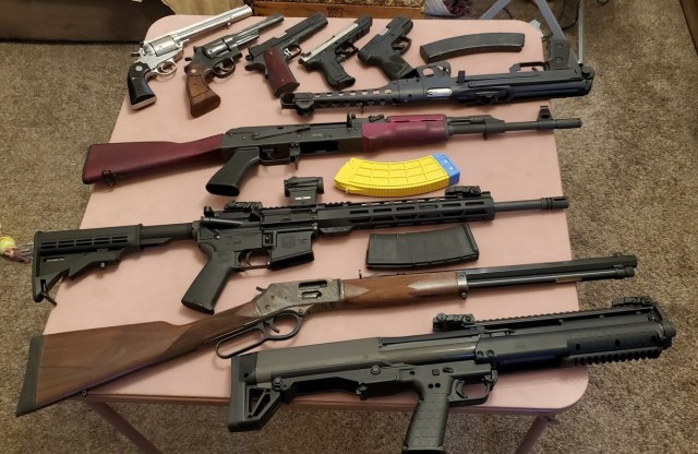 Rifles and pistols on table