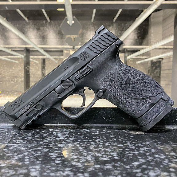 Smith and Wesson M&P 2.0 pistol with indoor shooting range background