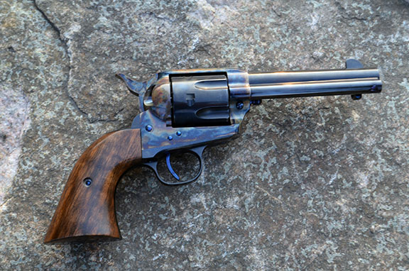 Standard Manufacturing Single Action Revolver right profile with a stone backdrop