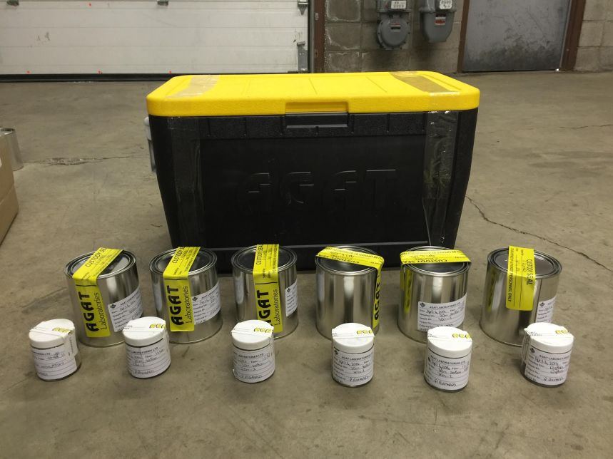 AGAT Cooler with samples lined up and sealed with legal sampling tape. Photograph of samples collected as part of legal investigation showing samples all sealed with tamper proof seals.