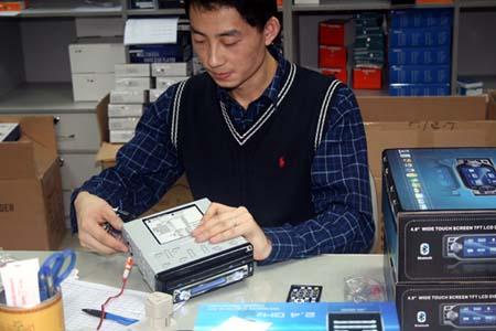 Chinavasion quality control, checking a car DVD.jpg