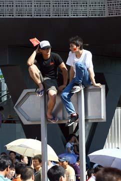 spectators securing a good vantage spot