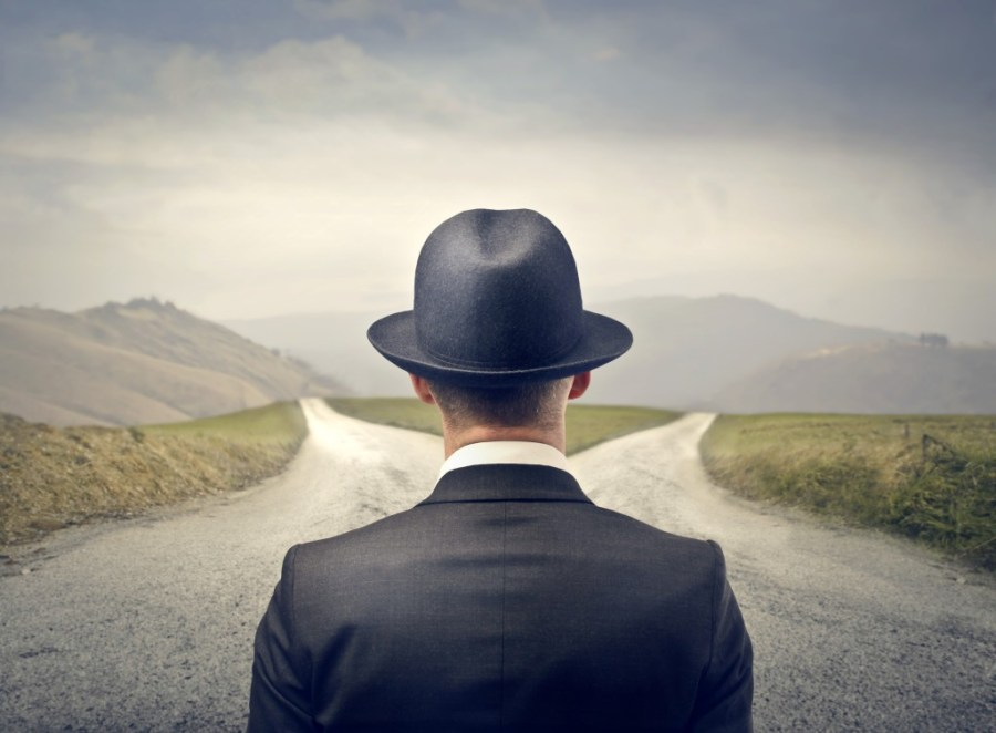 Man-Choosing-Between-Two-Roads-1024x753