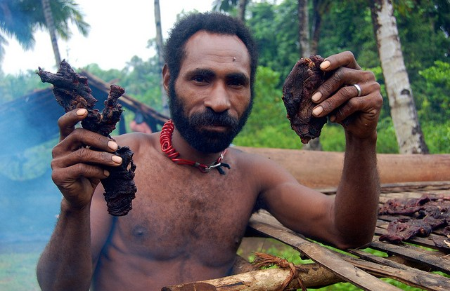 A man holds up bushmeat, Papua, Indonesia.   Photo by Agus Andrianto for Center for International Forestry Research (CIFOR).