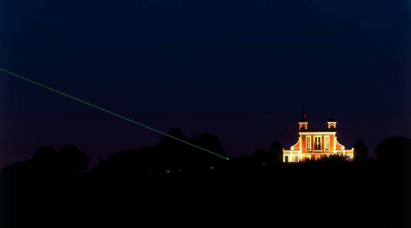 Royal Observatory at night showing laser