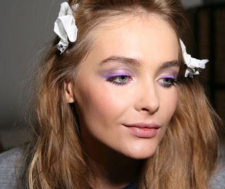 model-getting-her-makeup-done-backstage-at-versace-spring-2010-milan-fashion-week