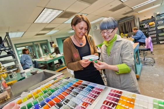 Kimiake Higuchi and Lisbeth Biger look at glass color samples