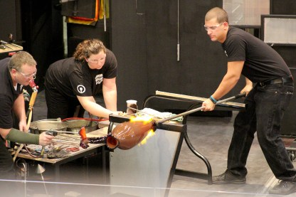 The Hot Glass Demo team works on the first piece officially made in the Amphitheater Hot Shop