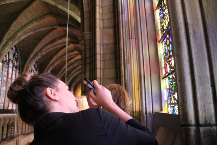 Natasa takes a photo of a stained glass window in St. Thomas.