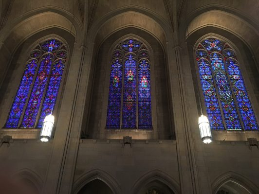 Three stained glass windows lining the nave of one side of the Church of the Heavenly Rest, New York City. The Whitefriars monks on the bottom right corners of these windows are so small compared to the scale of the windows, they required binoculars to view!