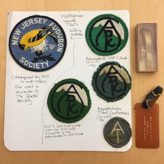 Tait's hiking patches, clothing labels, and luggage tag