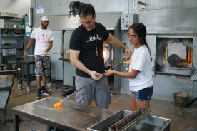 Instructor Ross Delano helps student Ivy Velez with her marvering technique.