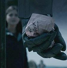 Cybernman hand clutching Danny Pink's paperwork.