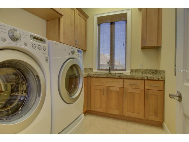 Natural wood and soft wall colors make the laundry space in this Redington Beach, FL brings the beach to a home...without the sand, of course.