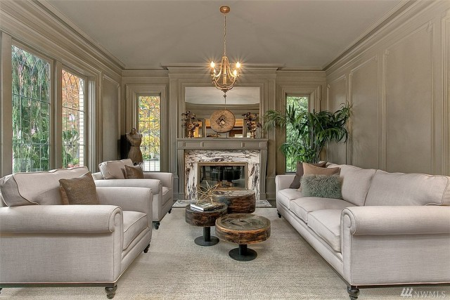 Winter white has a new meaning in this inviting space. We love the marble fireplace and